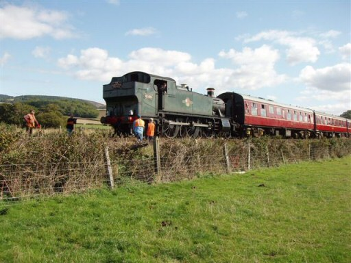 2010 - The WSRA PW Gang stand aside as BR(W) 2-6-2T No. 4160 passes with the Quantock Belle near Williton Bridge on 26 September. This work is licenced under a Creative Commons Licence. © Malcolm Anderson