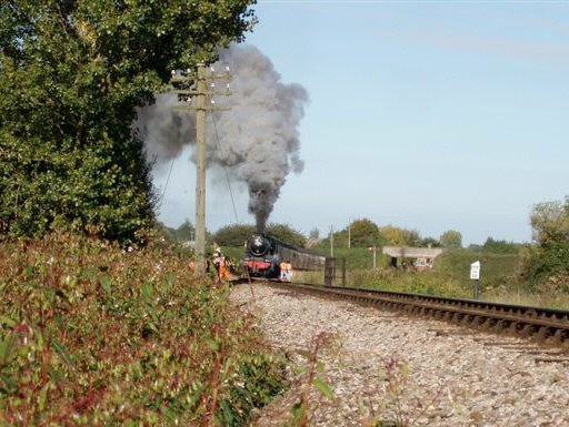 2010 - The WSRA PW Gang stand clear as LMS 4-6-0 No. 44767 George Stephenson leaves Williton on 17 October. This work is licenced under a Creative Commons Licence. © Malcolm Anderson