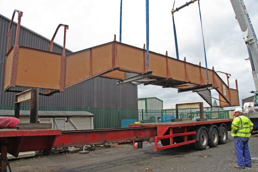 2010 - Williton Footbridge - in the air and being guided on to the low loader by Dave Chapman of Tema Engineering on 14 July. This work is licenced under a Creative Commons Licence. © Martin Hope