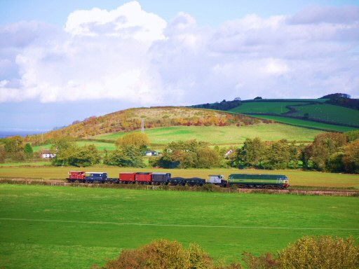 2010 - With a goods train in tow, Class 47 No. D1661 North Star heads away from Williton on 6 November. This work is licenced under a Creative Commons Licence. © Bradley Cottrell