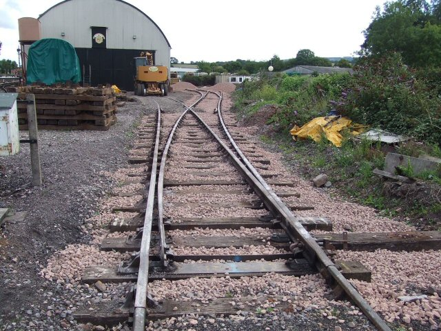 2011 - A view from the North Yard at Williton facing south, showing the new point turning right, leading on to the second new point. The left tails from this second point will go to the new loco lifting pad and siding along the side of the Swindon Shed and the right tails into Sherrings Yard for future development. Seen here on 6 August. This work is licenced under a Creative Commons Licence. © Ray Waldron