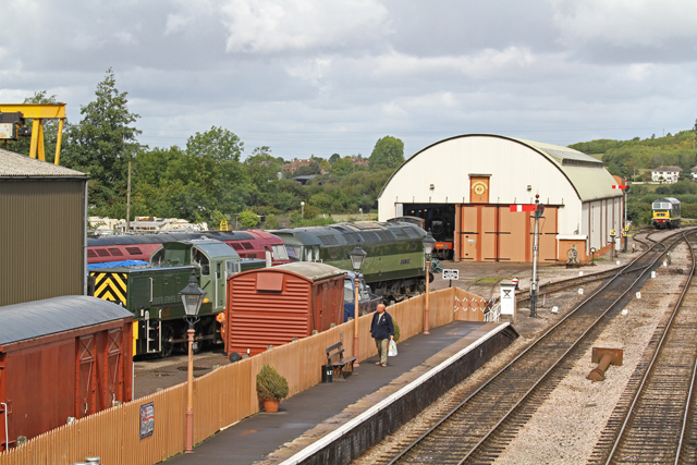 "2011 - A view of the South Yard and Swindon Shed from the Williton Footbridge on 27 August. Class 14 'Teddy Bear' No. 9526, Class 47 ""North Star"" D1661 and Class 52 'Western' No. D1010 'Western Campaigner' can be seen. Class 35 'Hymek' No. 7017 is in the siding above the North Yard whilst ""Raveningham Hall"" can just be seen inside the Swindon Shed. This work is licenced under a Creative Commons Licence. ©Martin Hope"