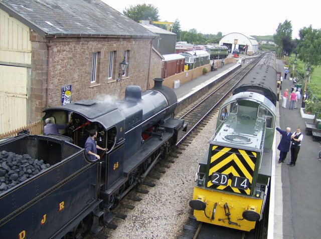 2011 - Class 14 No. D9526 waits at Williton as SDJR 2-8-0 No. 88 arrives on 10 August. This work is licenced under a Creative Commons Licence. © Tony Guest
