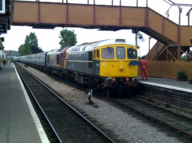 2011 - Class 33 No. D6566 and Class 67 No. 67028 with the 4.55pm 1Z41 Minehead to Watford Junction excursion at Williton on 9 July 2011. The double-headed eleven coach train nicely illustrates the need for the loop at Williton to be reinstated to its original length. This work is licenced under a Creative Commons Licence. © Brad Cottrell