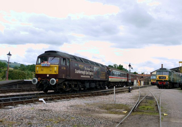 2011 - Class 47 No. 47826 with the Nenta Tours Norwich to Minehead excursion at Williton on 6 August Nos D7017 and D1661 in the South Yard. This work is licenced under a Creative Commons Licence. © Brad Cottrell