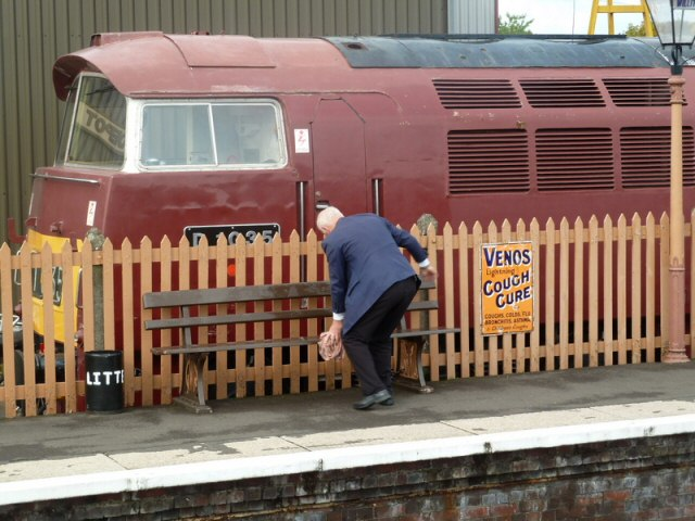 2011 - Dave Gillet drying the platform seats at Williton after a downpour on 4 September. This work is licenced under a Creative Commons Licence. © Sue Reynolds