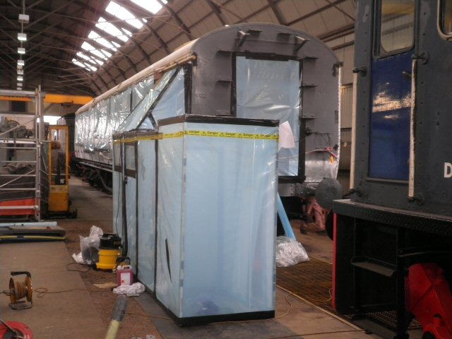 2011 - GWR BCK No. 6705 - seen here on 16 August - sealed and the working area set up to allow the safe removal of asbestos insulating strips from the seat backs in each compartment. The work is being carried out by MSS Environmental of Cardiff. This work is licenced under a Creative Commons Licence. © Chris Austin