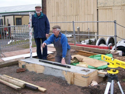 2011 - John Byfield and John Parsons assisting Claire Sheppy with checking out the levels for the base for the new footbridge at Williton. This work is licenced under a Creative Commons Licence. © Claire Sheppy