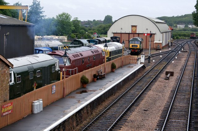 2011 - Many diesels at Williton South Yard on 30 May including Nos D7017, D1010, D6566 and 33057. Picture taken from the footbridge with special consent of the project manager. The footbridge is not yet available for public use. This work is licenced under a Creative Commons Licence. © John Hallett