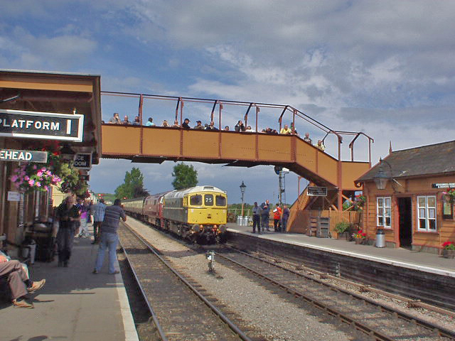 "2011 - The footbridge being well used on 3 September. Class 33 D6566 has just reversed failed D1010 ""Western Campaigner"" back on to Platform 2. This work is licenced under a Creative Commons Licence. ©Philip Gouldson"