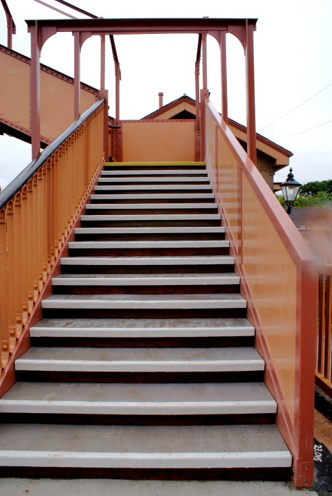 2011 - The footbridge steps on the Down side of Williton Station on 30 May. Picture taken from the footbridge with special consent of the project manager. The footbridge is not yet available for public use. This work is licenced under a Creative Commons Licence. © John Hallett