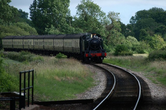 2011 - With eight coaches in tow, BR(W) 2-6-2T No. 4160 approaches Williton on 25 June. This work is licenced under a Creative Commons Licence. © Bev Zehetmeier