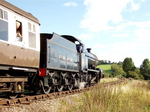 2010 - SDJR 2-8-0 No. 88 heads up the 1 in 99 away from Williton Bridge towards Castle Hill on 26 September. This work is licenced under a Creative Commons Licence. © Malcolm Anderson