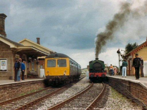 1982 - The Cravens DMU and Bagnall 0-6-0ST No. 2994 Vulcan at Williton. This work is licenced under a Creative Commons Licence. © Brian Hart