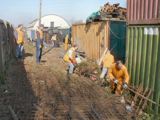 2010 - The Cutting Back Gang completing the clear-up along the boundary fence at Williton on 13 March. This work is licenced under a Creative Commons Licence. © Lumber Jack