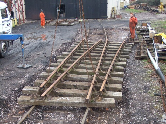 2011 - The new pointwork being overlaid to establish the position for leading off to the new siding at Sherring's Yard, Williton on 20 February. This work is licenced under a Creative Commons Licence. © Ray Waldron