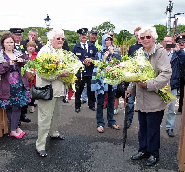 2011 - Williton Station Footbridge Official Opening - Mary Parsons and Jean Byfield showing the boquets of flowers they had been presented with in appreciation of their support to their husbands who had spent many hours working on the Footbrodge Project. This work is licenced under a Creative Commons Licence. © Beverley Zehetmeier