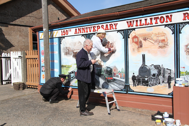 2012 - Tad and Brenda Mandziej making last minute adjustments to the Williton Station mural on 31 March. This work is licenced under a Creative Commons Licence. ©Martin Hope