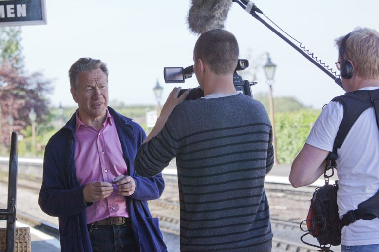 2012 Michael Portillo at Williton Station during filming for the next series of the BBC's Great British Railway Journeys on 23 May 2012. This work is licenced under a Creative Commons Licence. © Tim Stanger