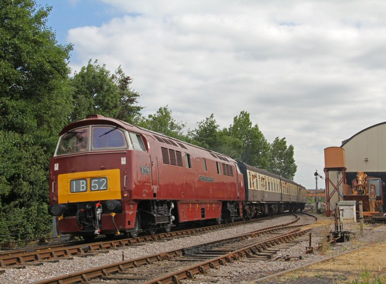 2013 - Class 52 No. D1010 'Western Campaigner' heads away from Williton on 20 July. This work is licenced under a Creative Commons Licence. © Brad Cottrell.