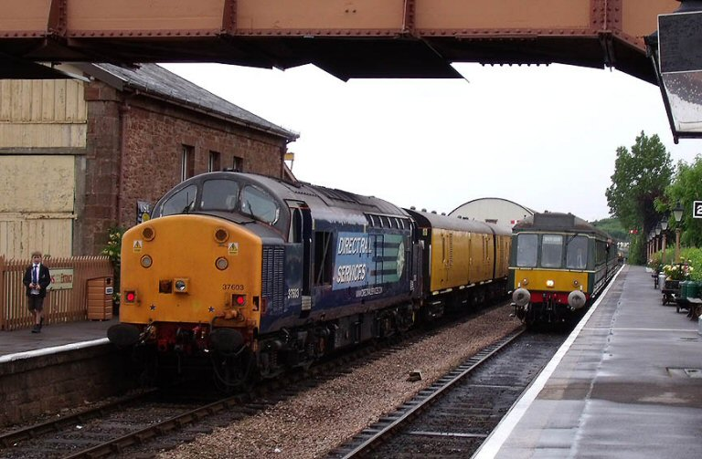 2013 - DRS Class 37 No. 37603 waits with the ultrasonic test train at Williton as the DMU on an Up service arrives on 12 June. This work is licenced under a Creative Commons Licence. © Martin Southwood.