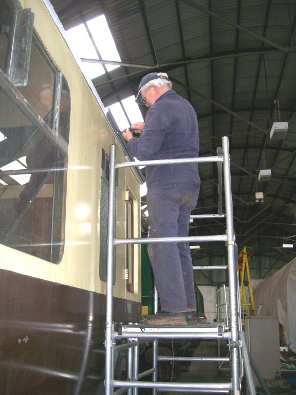 2013 - Fixing the gutter of GWR BCK No. 6705 at Williton is West Somerset Steam Railway Trust Chairman Chris Austin on 24 November. This work is licenced under a Creative Commons Licence. © Claire Sheppy.