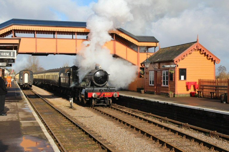 2013 - Framed by the footbridge WSR 2-6-0 No.9351 makes a stirring sight as it leaves Williton on 14 February. This work is licenced under a Creative Commons Licence. © Simon Bacon.