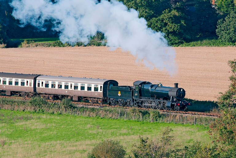 2013 - GWR 2-8-0 No. 3850 working hard on the 1 in 99 gradient near the Doniford stream on 15 October. This work is licenced under a Creative Commons Licence. © Alan Turner.