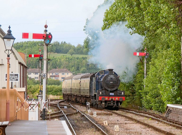 2013 - SDJR 2-8-0 No. 88 pulls into Williton with a special excursion arranged for the Somerset and Dorset Railway Trust on 17 August. This work is licenced under a Creative Commons Licence. © Alan Turner.