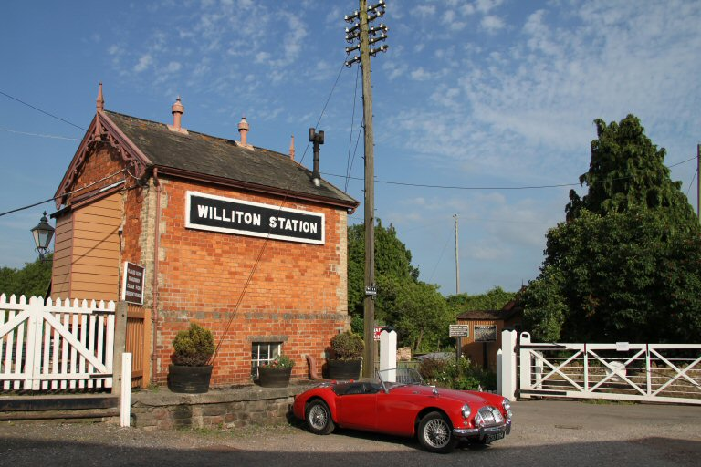 2013 - A timeless scene at Williton - a 1957 MGA basks in the afternoon sunshine on 5 July. This work is licenced under a Creative Commons Licence. © David Soper.