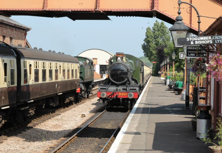 2013 - Up and Down trains pass at Williton. BR(W) 2-6-2T No.4160 and WSR 2-6-0 No. 9351 on 16 July. This work is licenced under a Creative Commons Licence. © Simon Bacon.