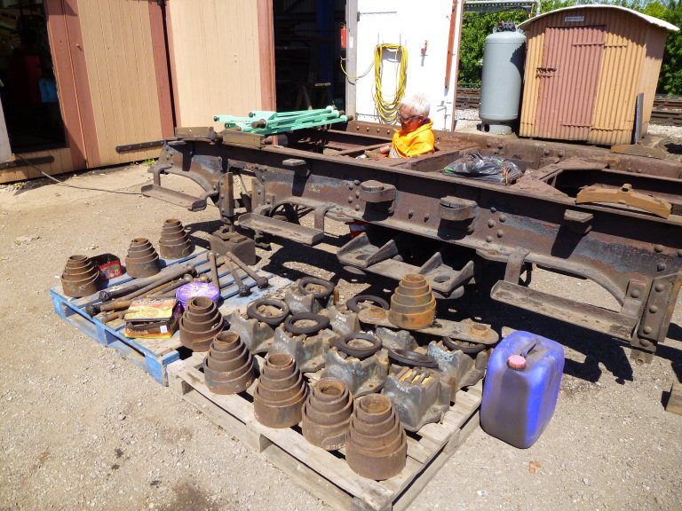 2013 - West Somerset Steam Railway Trust 6705 Working Party - Dozens of bogie components removed for cleaning and painting on 26 May. This work is licenced under a Creative Commons Licence. © Chris Austin.