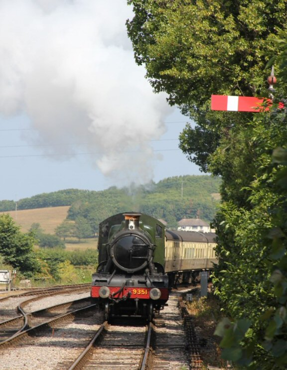 2013 - WSR 2-6-0 No. 9351 approaching Williton Station on 16 July. This work is licenced under a Creative Commons Licence. © Photophile69.