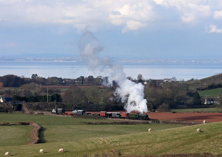 2013 - WSR 2-6-0 No. 9351 with an afternoon Up Goods seen leaving Williton on 18 March. This work is licenced under a Creative Commons Licence. © Peter Slater.