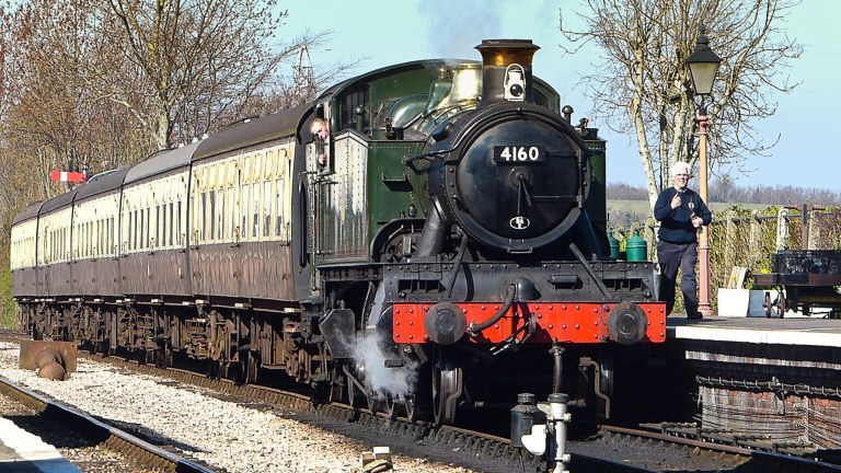 2014 - Driver Williams brings BR(W) 2-6-2T No. 4160 and its train in to Williton station on 16 March. This work is licenced under a Creative Commons Licence. © John Blackmore.