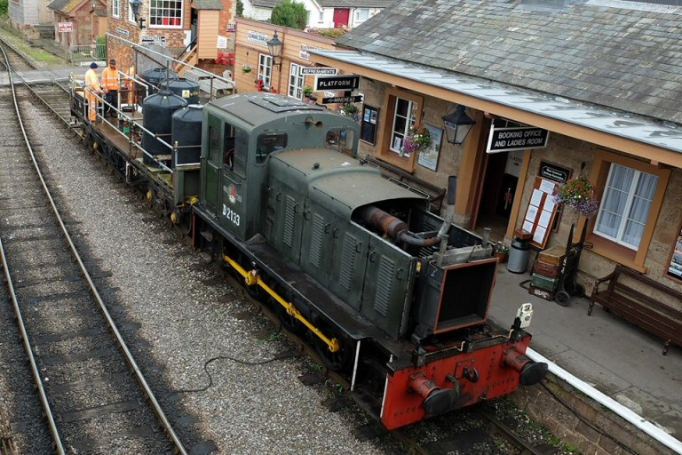 2014 - The half naked Minehead Pilot Class 03 No.D 2133 with the Weedkilling Train at Williton on 27 August. This work is licenced under a Creative Commons Licence. © Bev Zehetmeier.