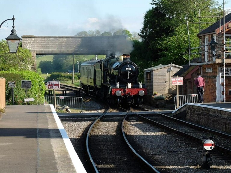 2014 - WR 4-6-0 No. 4936 'Kinlet Hall' approaching Williton Station on 15 May. This work is licenced under a Creative Commons Licence. © Bev Zehetmeier.
