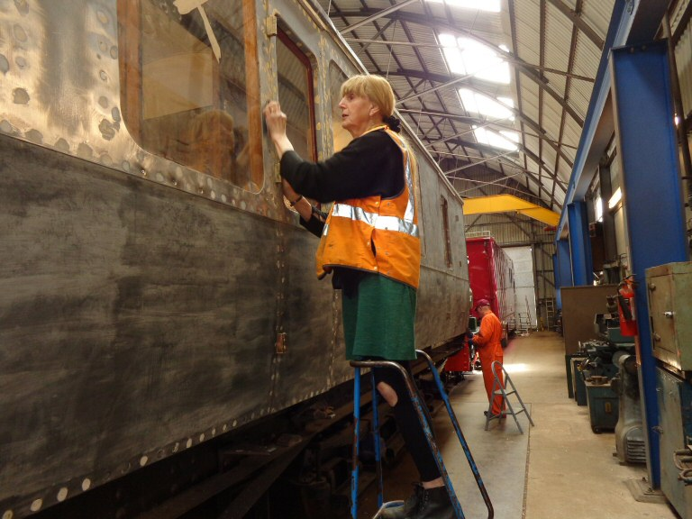 2015 - Claire Sheppy preparing the side of the West Somerset Railway Steam Trust's GWR BCK No. 6705 for a coat of Etching Primer paint at the Swindon shed Williton on 22 April. This work is licenced under a Creative Commons Licence. © Claire Sheppy.