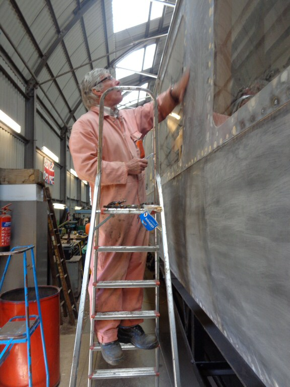 2015 - Greg McNelly preparing the side of the West Somerset Railway Steam Trust's GWR BCK No. 6705 for a coat of etching primer paint at the Swindon Shed at Williton on 22 April. This work is licenced under a Creative Commons Licence. © Claire Sheppy.
