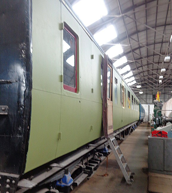2015 - One side of the West Somerset Railway Steam Trust's GWR BCK No. 6705 has already reeived a coat of etching primer paint at the Swindon Shed at Williton on 22 April. This work is licenced under a Creative Commons Licence. © Claire Sheppy.
