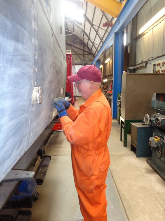 2015 - Peter Sennett preparing the side of the West Somerset Railway Steam Trust's GWR BCK No. 6705 for a coat of etching primer at the Swindon Shed Williton on 22 April. This work is licenced under a Creative Commons Licence. © Claire Sheppy