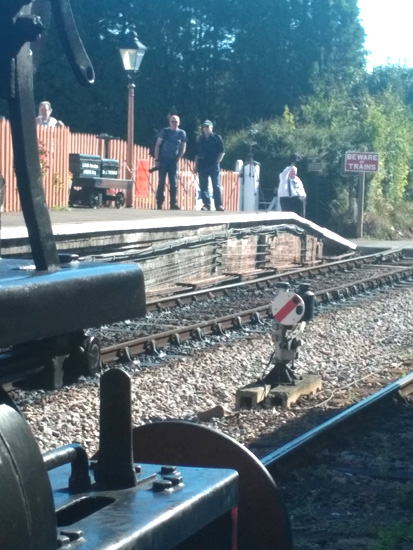 2018.09.27. Seen across the buffer of Ivatt Tank 41312 the ground signal comes off for the Down line to be used by the 13.40 up service. © Chris Hooper