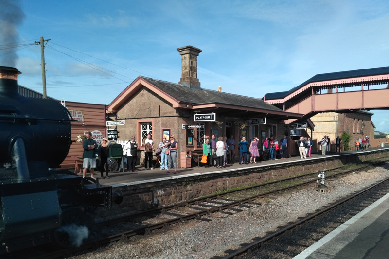 2018.09.15 A busy Williton Down platform during the Forties Weekend as the 11.02 Minehead service arrives. © Chris Hooper