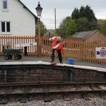 2018-05-10. Peter Payne bleach washing the station white line in prepareation for repainting.  © Richard Salt