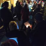 2018.12.11 Carol singers from the Minehead train on platform 2 sing to the fine accompaniment of the Wiveliscombe band. © Chris Hooper