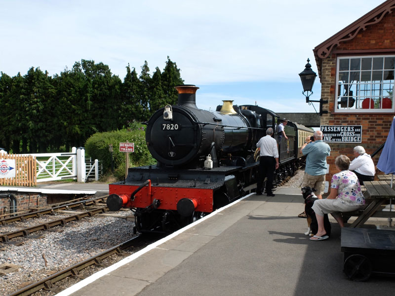 2017.07.17. The fireman on GWR 7800 class No.7820 'Dinmore Manor' ready with the token for the Williton signalman on an afternoon Down train. © Beverley-Zehetmeier