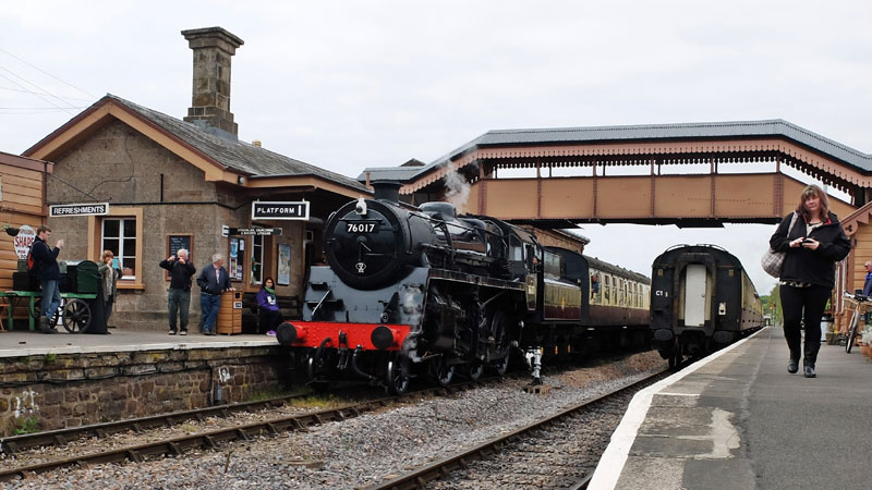 2017.04.28. Standard class 4MT No.76017 from the Mid Hants Railway awaits departure from Williton Platform 1 during the Spring Steam Gala. Notice both trains are 'wrong line'!  © Beverley-Zehetmeier