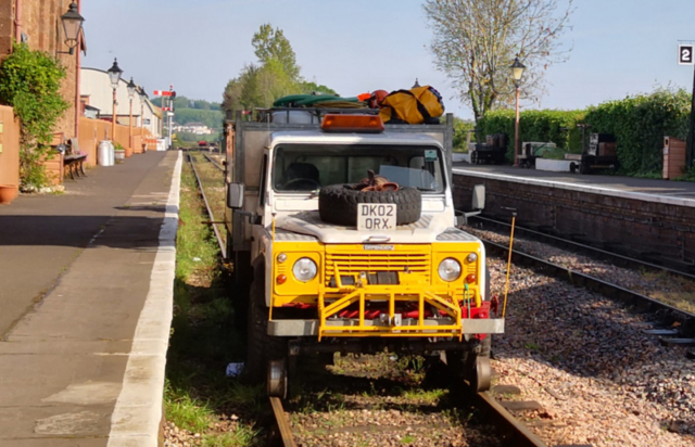 2019.04.30. This unusual locomotive/train is a contractor's weed-killing road-railler. Looks like it's on safari at Williton Station! © Richard Salt