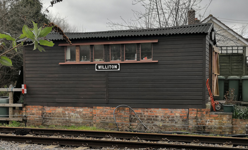 2019.03.19 John Byfield's completed repaint and signage of the Williton Station workshop. © Richard Salt